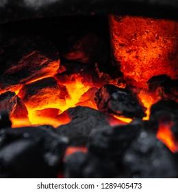 Burning coal in a furnace.