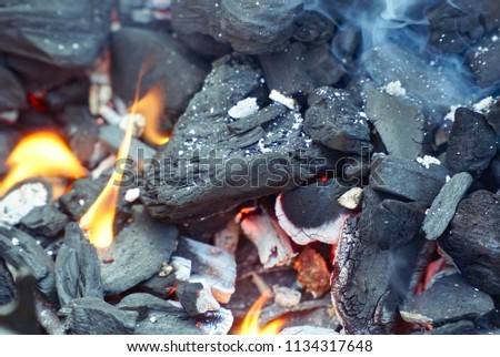 Burning coal on the bbq