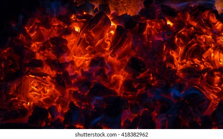 Burning coal, soft focus. Textures, background, abstract