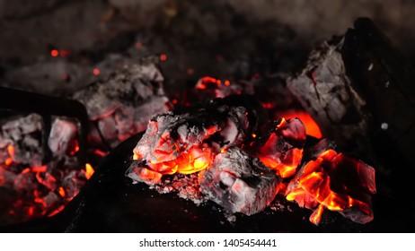 burning coals in the dark
