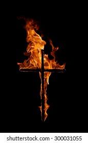 burning cross in black background