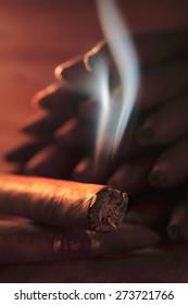 Burning Cuban cigar /  cigarette