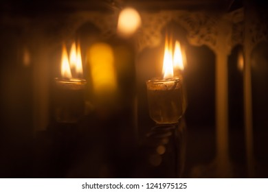 Burning festive oil candles in a decorated glass box, Chanukkah Hanukkah concept background with copy space