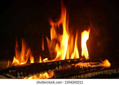 Burning fire in the brick fireplace