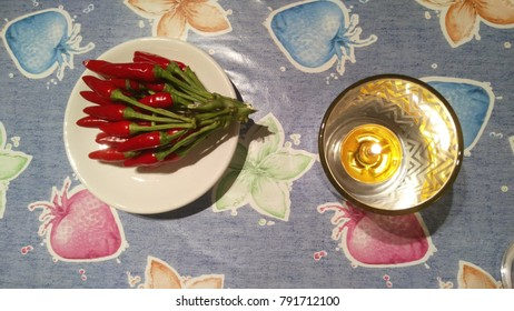 burning fire concept. cande burning near red spicy pepper
