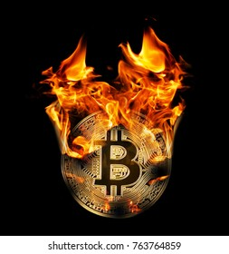 Burning in fire golden bitcoin isolated on black background