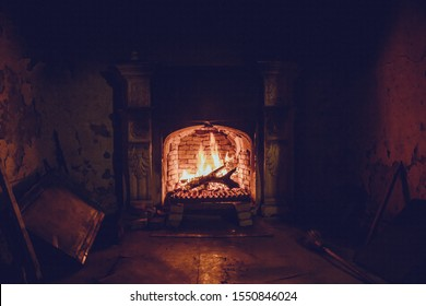 Burning fire in an old manor fireplace
