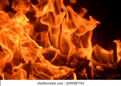 Burning fire with red, orange and yellow flames background. Arson, house fire, fire safety and fire danger theme.