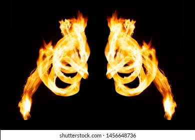 Burning fire wings on isolated black background