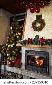 Burning Fireplace with christmas tree and decorations