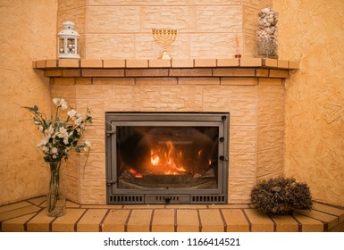 Burning fireplace. Fireplace as a piece of furniture. Burning wood in fireplace in a countryside house
