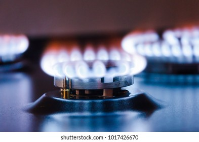 Burning gas burner. Blue fire with a red flame.