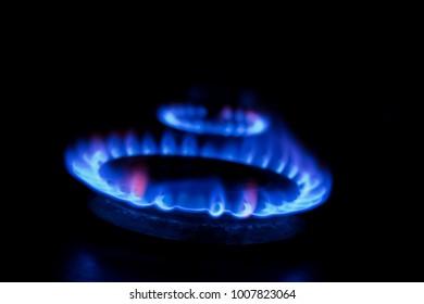 Burning gas burner on a black background