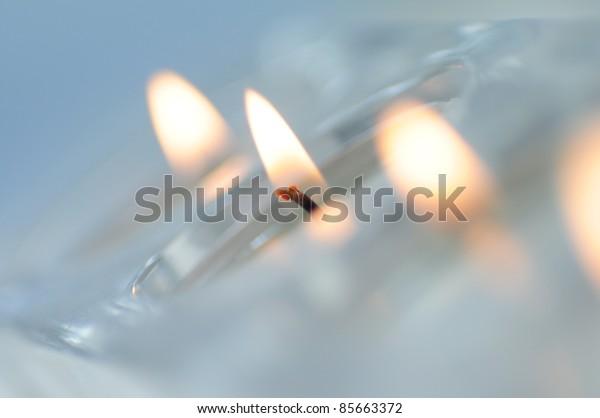 Burning Glass Decorative Candles. Deep Depth of Field.