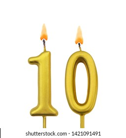 Burning golden birthday candles isolated on white background, number 10