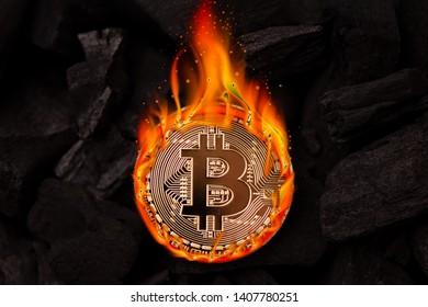 Burning golden bitcoin coin close up