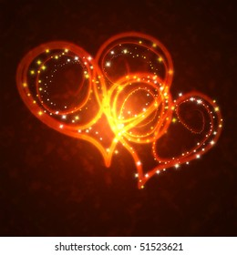 burning hearts with sparkles on a dark background