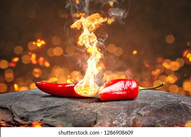 Burning hot chili pepper with a flame