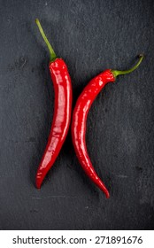 Burning hot vibrant red mexican chilli peppers