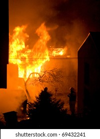burning house, firefighters trying to extinguish the fire