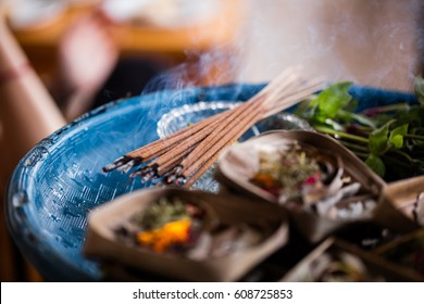 Burning incense in offering woven basket