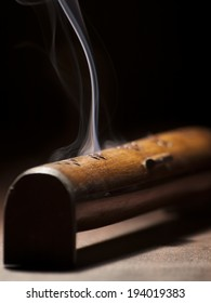 burning incense stick in the box, for religious, spiritual,healing themes