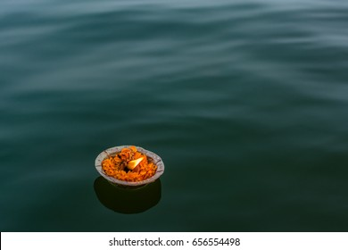 burning lamp floating in the sacred water of holy river ganga in varanasi india