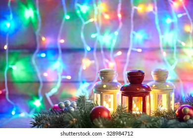 Burning lanterns and christmas decoration with copy space