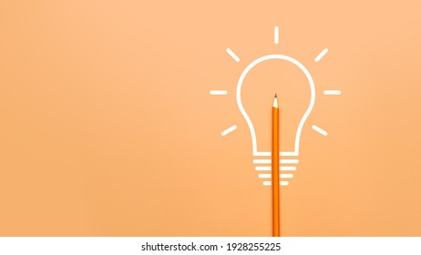 A burning light bulb and a pencil. A symbol of a difficult task and the emergence of a creative idea to solve it