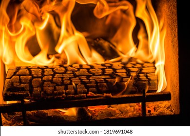 A Burning log inside a Log Burner creating heat on a cold winters day