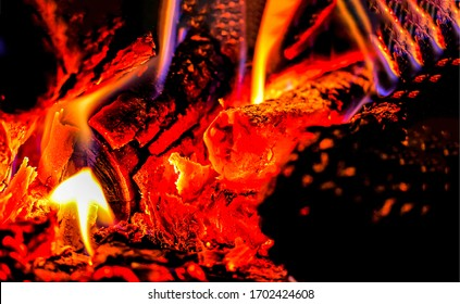 Burning logs tongue of flame. Burning logs close up. Logs are burning