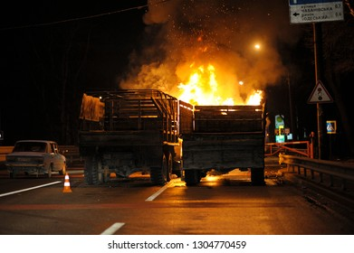 Burning lorries standing near barricades built on a highway near Teremki district. Revolution of Dignity. February 20, 2014. Kiev, Ukraine