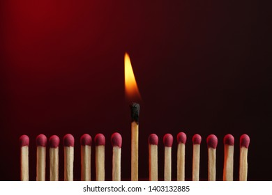 Burning match among others on color background. Difference and uniqueness concept