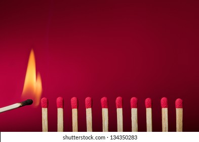 Burning match setting fire to its neighbors, a metaphor for ideas and inspiration