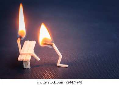 Burning matches, like people. guy kneels in front of the girl and asks for forgiveness. relationship problem Concept