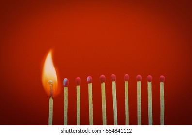 Burning matchsticks setting fire to its neighbors, a metaphor for ideas and inspiration