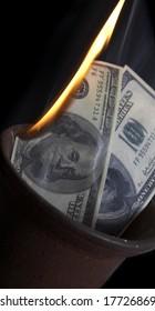 Burning of money on fire