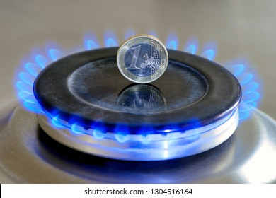 Burning natural gas and one euro coin on gas hob. The concept of the struggle for global gas markets. Turk stream. North stream