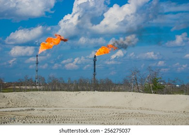 Burning oil gas flare