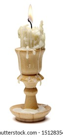burning old candle vintage wooden candlestick. Isolated on a white background. wooden candle holder.