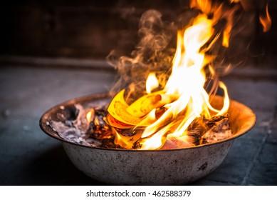 Burning paper for ancestors passed away