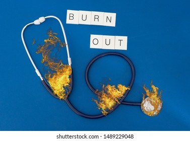 burning phonendoscope with writing burn out represents the concept of burn out for health personnel