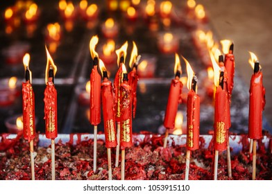 Burning red chinese candle at Wat Mangkon Kamalawat famous Chinese temple in Bangkok, Wat Mangkon Kamalawat (Leng Noei Yi). close up shot