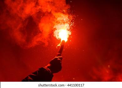 Burning red flare, flame, football hooligan