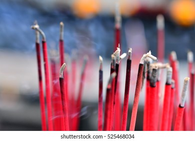 Burning red incense sticks at a buddhist temple