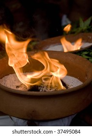 Burning rock incense in a clay pot
