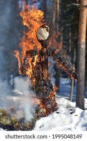 Burning scarecrow on festival maslenitsa. Slavic national spring pagan festival - Maslenitsa. Burning effigies straw on traditional holiday dedicated to spring - slavic celebration shrovetide - Shutterstock ID 1995048149