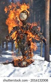 Burning scarecrow on festival maslenitsa. Slavic national spring pagan festival - Maslenitsa. Burning effigies straw on traditional holiday dedicated to spring - slavic celebration shrovetide - Shutterstock ID 2016132008