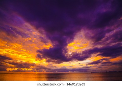 Burning sky and sea during sunset with vibrant colors and impressive cloud formations after rain and storm - Ko Lanta, Thailand