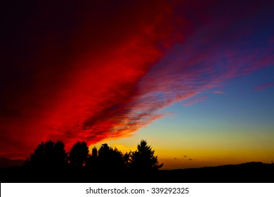 burning sky Violent clouds flow across the sky and gild the sunset